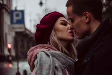close up photograph of woman kissing man