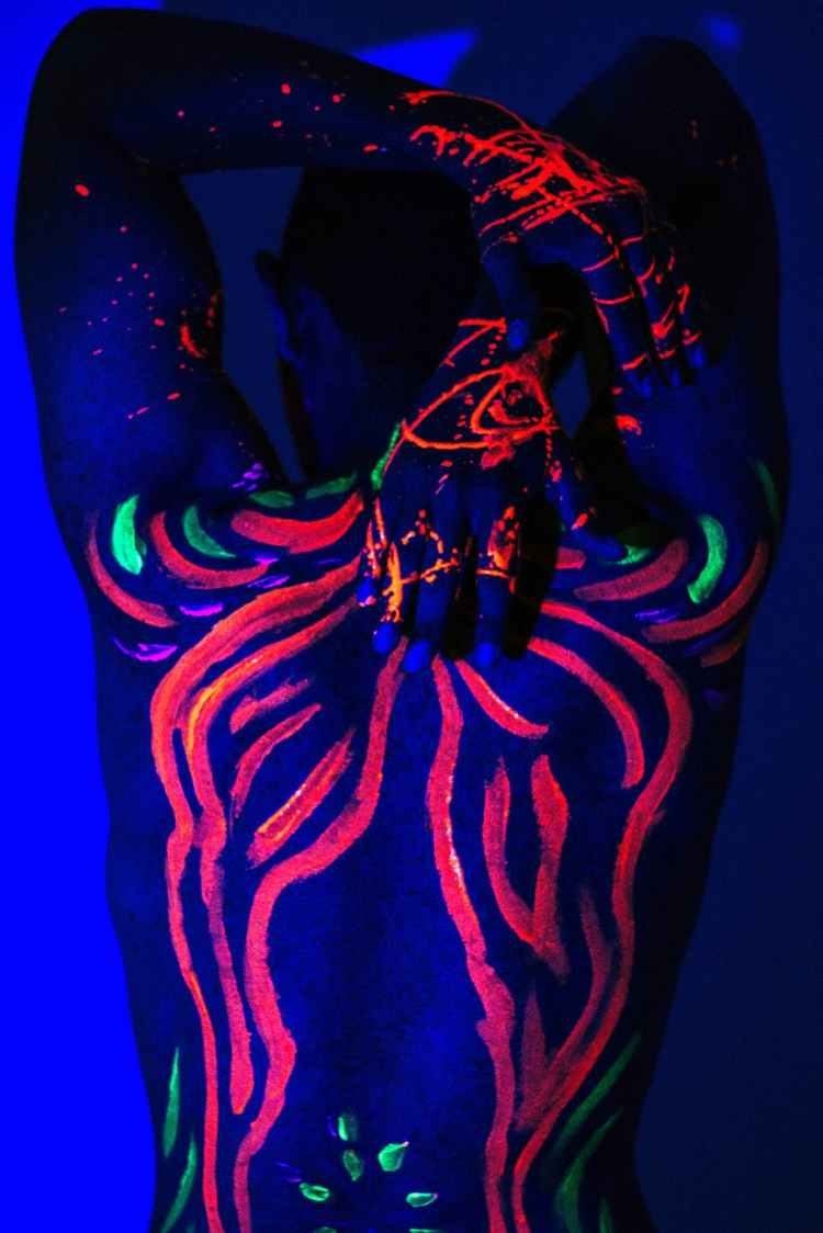 person with neon body art