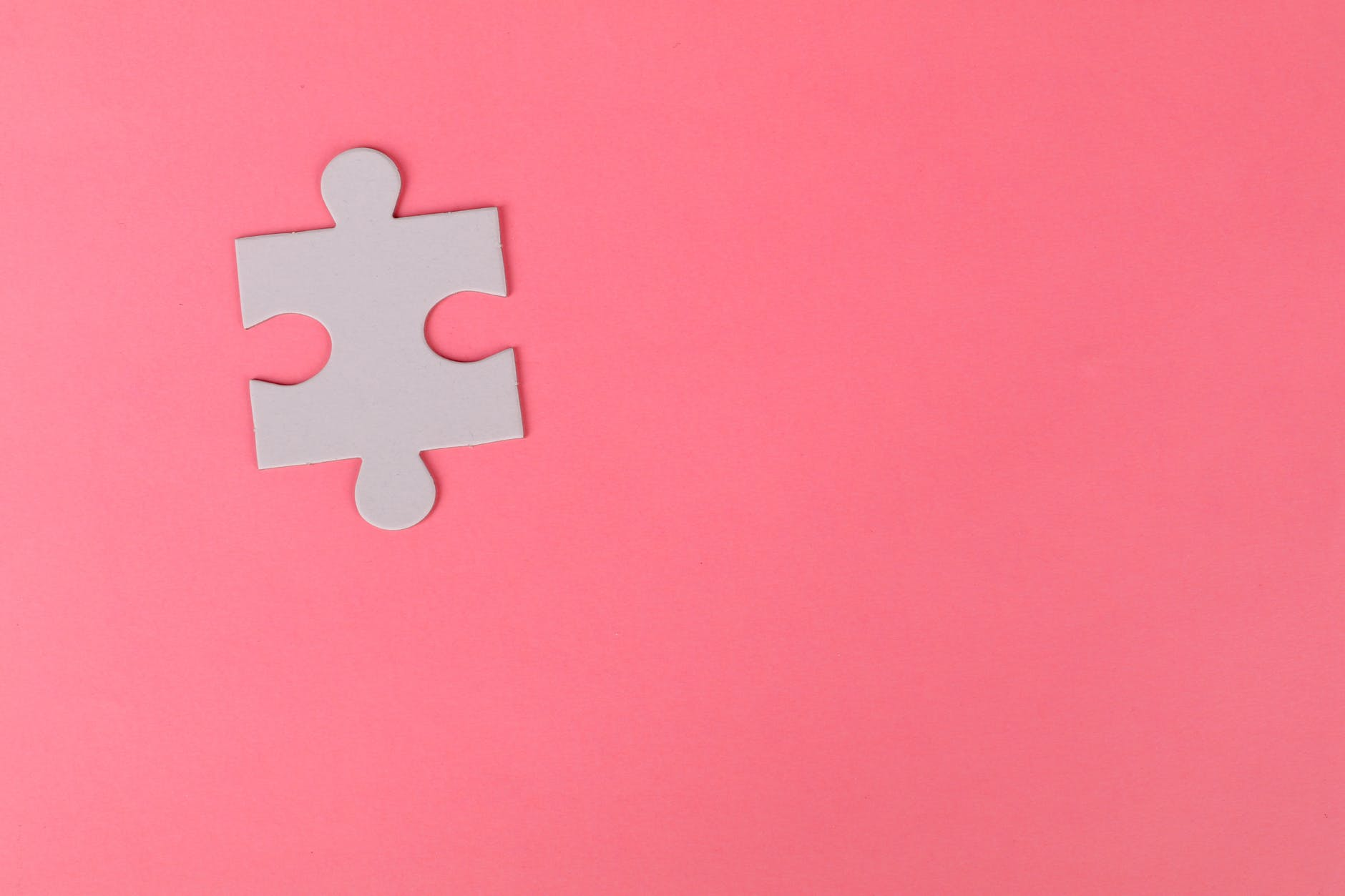 jigsaw puzzle on pink background